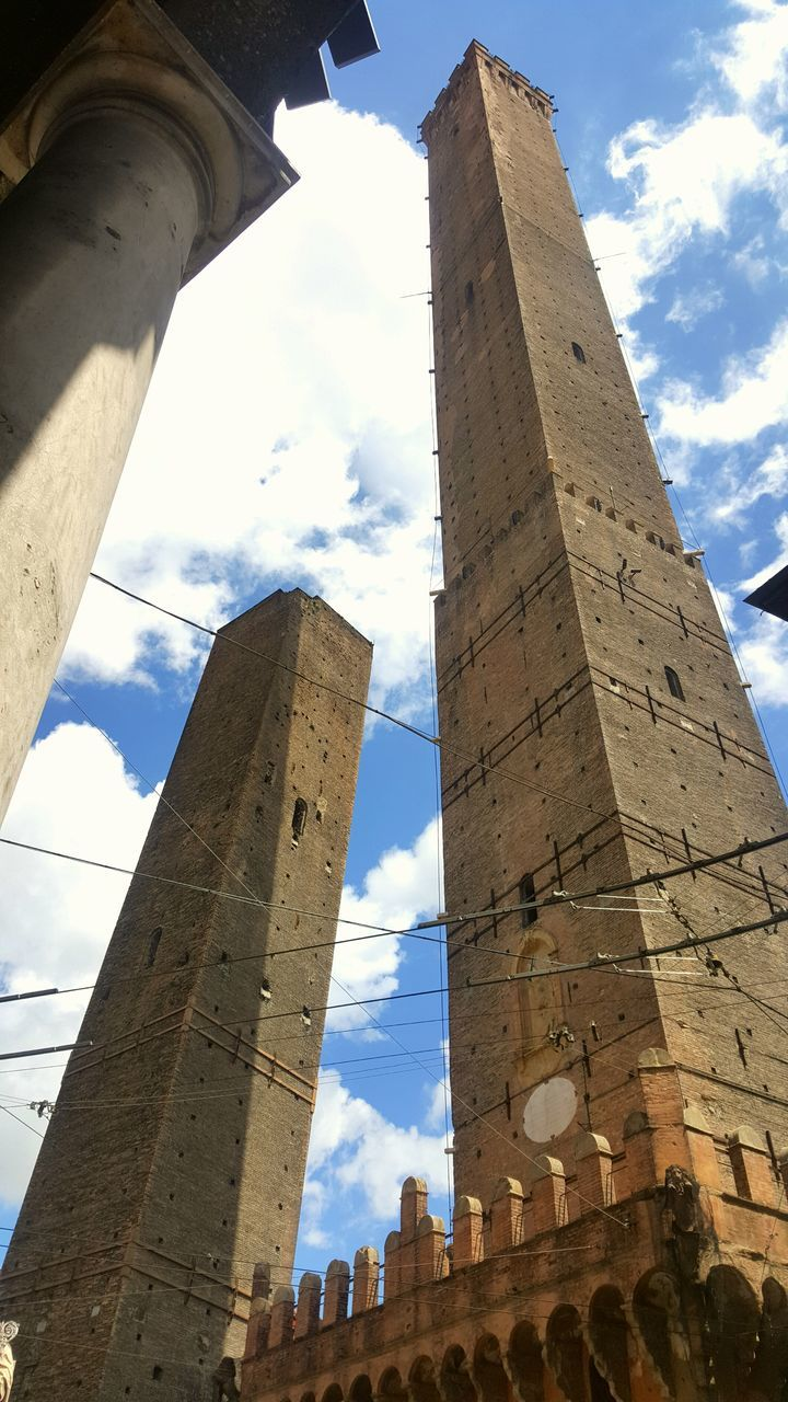 architecture, history, built structure, low angle view, sky, cloud - sky, the past, ancient, ancient civilization, architectural column, day, sunlight, travel destinations, old ruin, building exterior, outdoors, no people, city