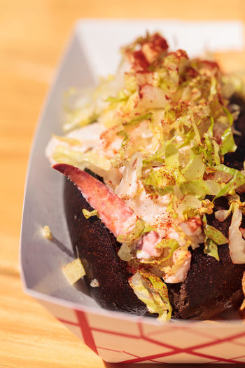 Gourmet Maine Lobster roll on a pumpernickel bun and potato chips at the beach in summer. Chips Close-up Fast Food Fish And Chips Food Freshness Gourmet Indoors  Lobster Lobster Roll No People Pumpernickel Ready-to-eat SLAW