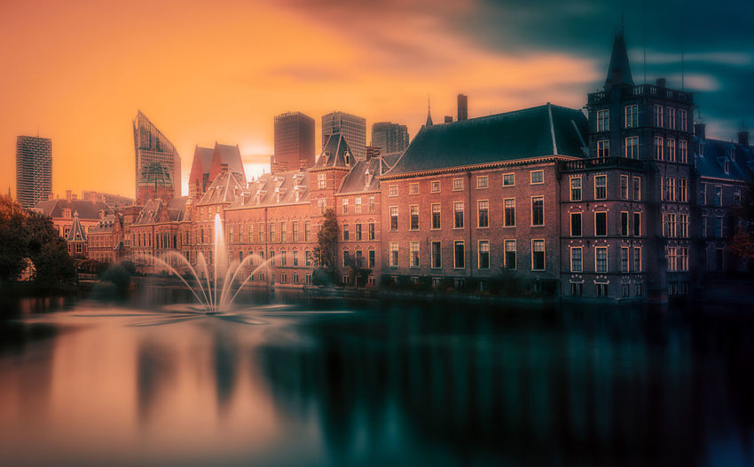 Holland Dutch Remo SCarfo EyeEm Best Shots EyeEmNewHere Sunset Built Structure Architecture Building Exterior Water Sky Building Waterfront City Reflection Nature No People Illuminated River Bridge Connection Dusk Urban Skyline Cloud - Sky Outdoors Office Building Exterior Skyscraper