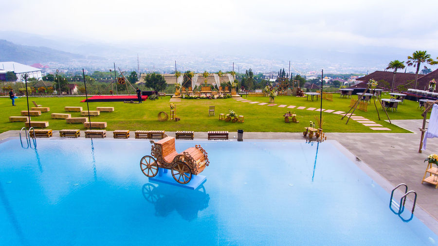 the arrangement of the concept of outdoor wedding stage decorations Pool Leisure Activity Water Swimming Pool Day Nature Lifestyles One Person Real People Plant Sky Tree Full Length Cloud - Sky Outdoors Reflection Grass Sunlight Wedding Wedding Dress Wedding Photography Wedding Ceremony Wedding Day Decoration Decor