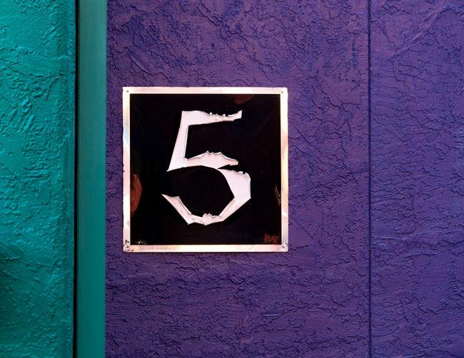 Number 5 on purple wall