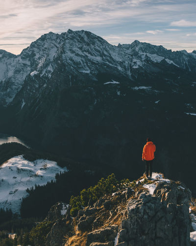 Person standing at mountain top looking into a valley Adventure Architecture Beauty In Nature EyeEm Best Shots EyeEm Nature Lover Forest Landscape Landscape_Collection Landscape_photography Mountain Mountain Peak Mountain Range Nature Night No People Orange Outdoors Person Scenics Sky Travel Travel Destinations Tree Valley