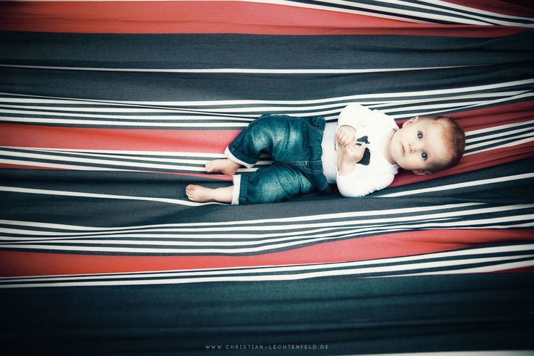 Hangaround Kids Of EyeEm Baby Canvas Children Children Of The World Children's Portraits Kids Kids Being Kids Baby Boy Casual Clothing Child Childhood Childhood Memories Children Only Children Photography First Eyeem Photo Hammock Kid Kids Photography Kids Portrait Kidsphotography Lying Down Lying On Back Relaxation Resting EyeEmNewHere