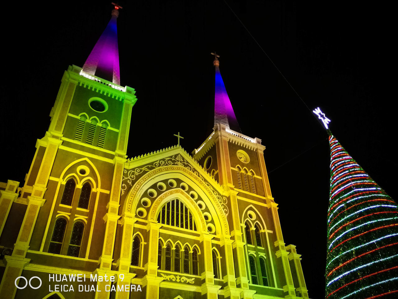 night, architecture, illuminated, building exterior, built structure, low angle view, tourism, place of worship, government, religion, travel destinations, multi colored, outdoors, spirituality, patriotism, dome, no people, sky, city, black background
