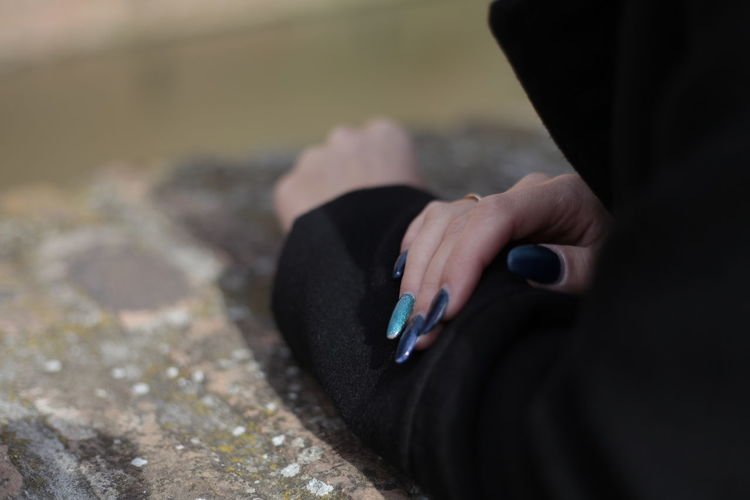 Cropped Image Of Woman Showing Nail Polish