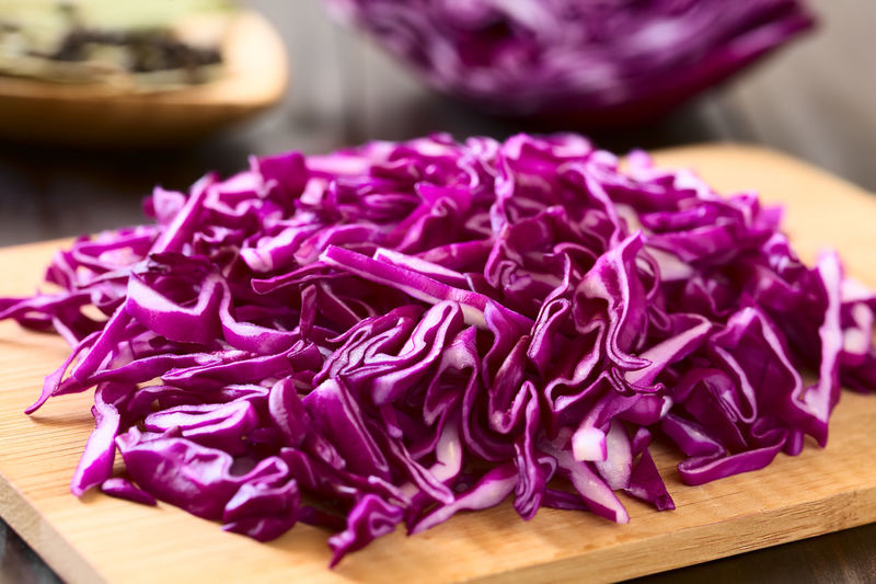 Raw red cabbage chopped on wooden board, photographed with natural light (Selective Focus, Focus one third into the red cabbage) Cooking Horizontal Raw Red Blue Cabbage Chopped Close-up Cruciferous Cutting Board Food Food And Drink Fresh Freshness Healthy Healthy Eating Ingredient Kraut Purple Raw Food Shredded Uncooked Vegetable