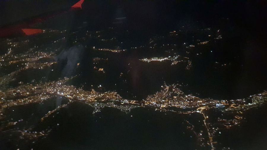 Aerial view of illuminated city during night