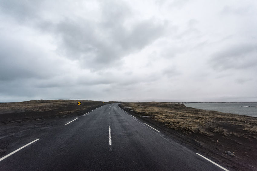 Landscape in Iceland Beauty In Nature Cloud Cloud - Sky Cloudy Country Road Day Diminishing Perspective Empty Empty Road Landscape Long Nature No People Non-urban Scene Outdoors Overcast Remote Road Road Marking Scenics Sky The Way Forward Tranquil Scene Tranquility Vanishing Point