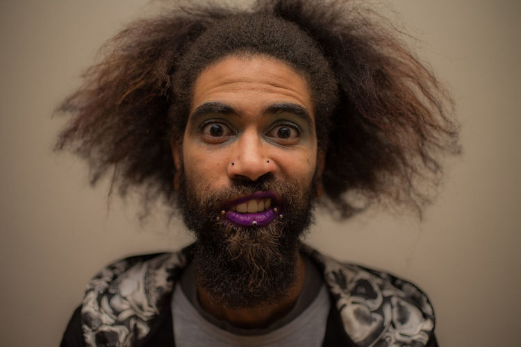 Portrait Of Hipster Man With Purple Lipstick