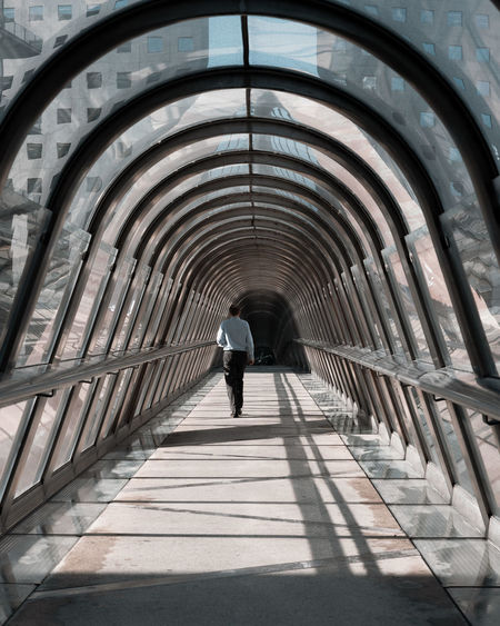 Rear view of man walking in the japan tunnel in paris