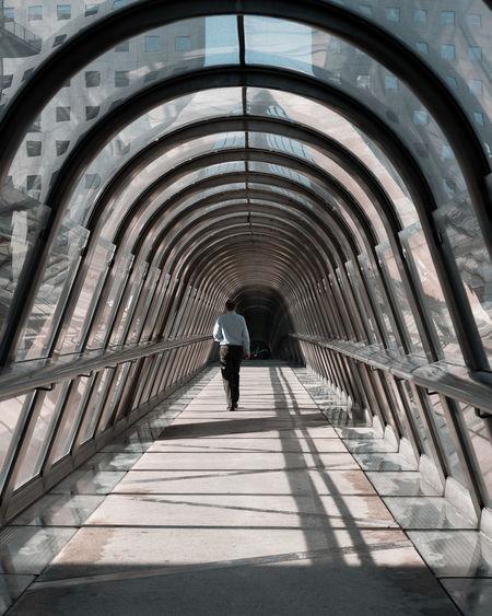 Rear view of man walking in the japan tunnel in paris