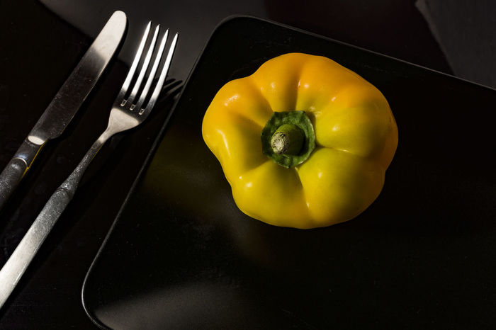 Black Background Black Plate Close-up Day Dinning Food Food And Drink Fork Freshness Healthy Eating Indoors  Knife & Fork Knife And Fork No People Pepper Plate Still Life Table Yellow Yellow Pepper Yellow Pepper On Black Plate The Week On EyeEm Food Stories The Still Life Photographer - 2018 EyeEm Awards