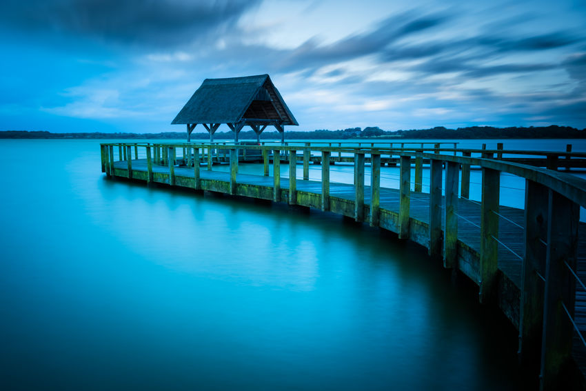 Storm Sebastian Autumn Fresh On Eyeem  Hemmelsdorfer See Storm The Week On EyeEm Architecture Blurred Motion Built Structure Day Lake Lake View Landing Stage Lee Filters Long Exposure Moving Clouds Nature No People Outdoors Reed Sea Sky Sturmtief_sebastian Water Betterlandscapes Landscape An Eye For Travel