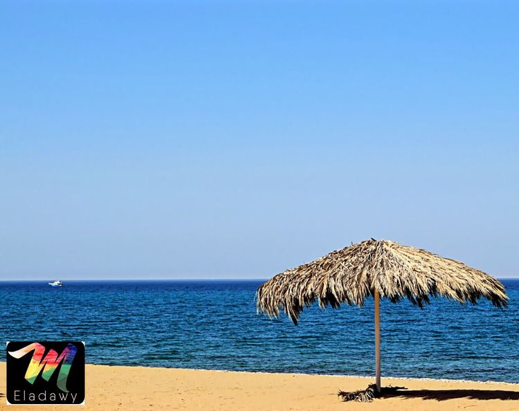 Beach Sea Sand Copy Space Nature Tranquility Water Blue Protection Thatched Roof Horizon Over Water Vacations No People Beauty In Nature Day Summer Scenics Clear Sky Outdoors Sky Sokhabeach Sokhna , Egypt Sokhna Sunlight Wood - Material