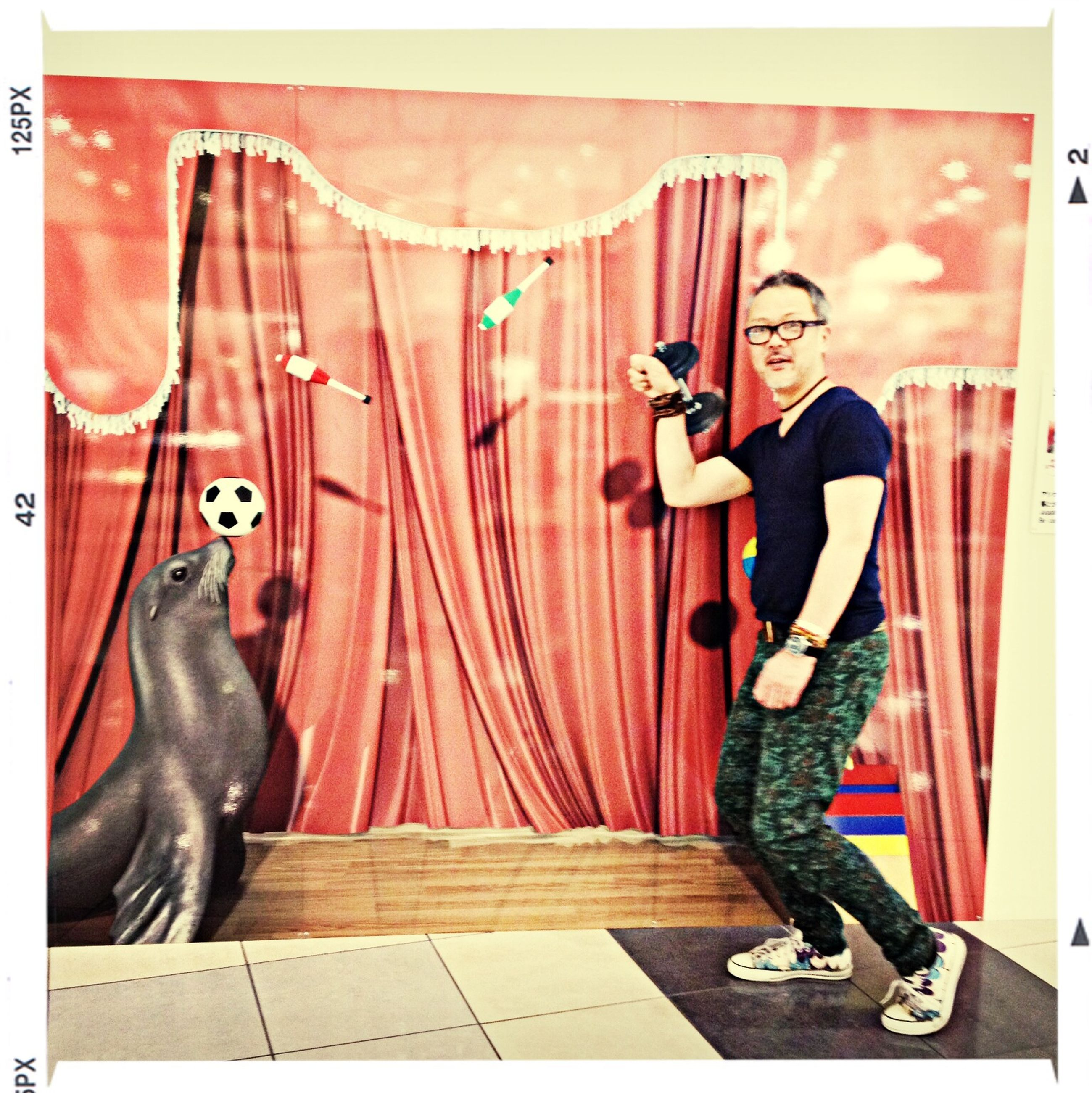 transfer print, auto post production filter, indoors, full length, animal representation, art and craft, human representation, wall - building feature, art, creativity, wood - material, door, standing, shoe, day, red, lifestyles