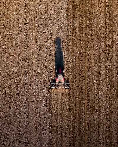 Directly above tractor on agricultural field