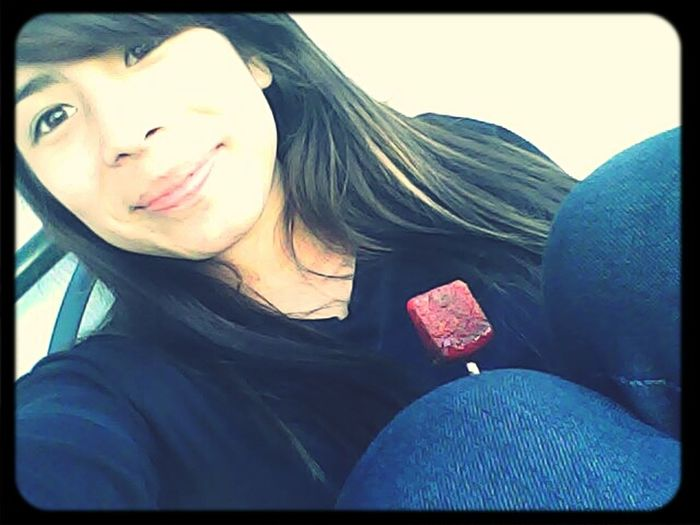 me with my lollypop!c: ahah got bored outside!;o