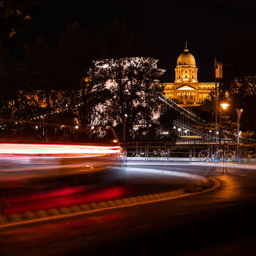 Illuminated light trails on building at night