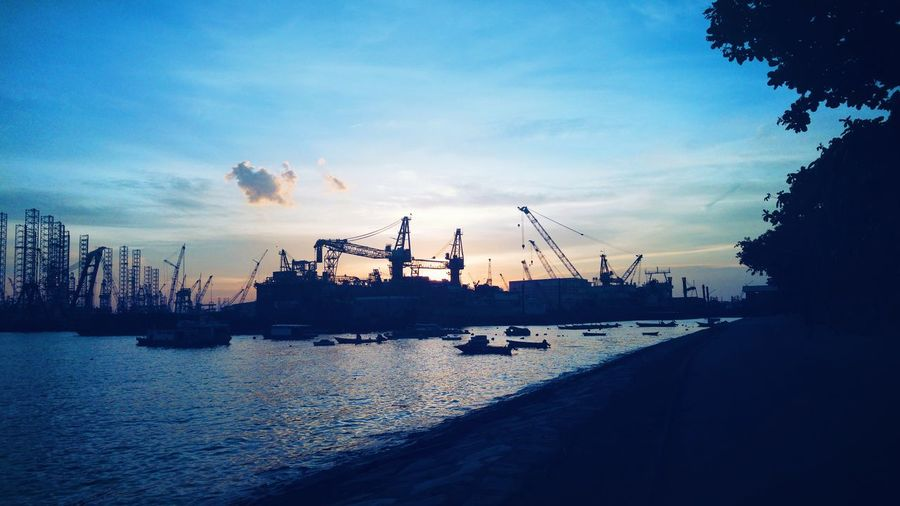 Commercial dock against sky during sunset