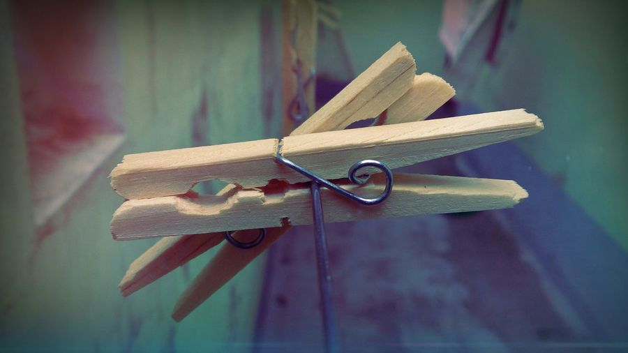 Close-up of wooden clothespins on rope