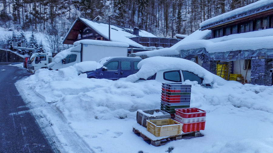 Snow Winter Cold Temperature Architecture Building Exterior Built Structure Building White Color Day House Mode Of Transportation Nature Transportation Covering Land Vehicle Residential District No People Frozen Outdoors Wheel