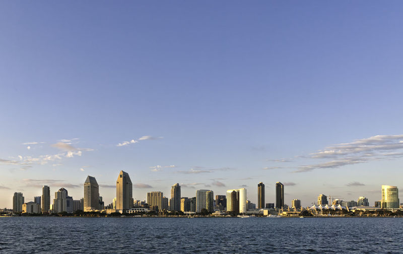 Skyline of San Diego at sunset, USA. Buildings and skyscrapers in California. Concept for travelling and business with copyspace Business Coastline Downtown Harbor Panorama San Diego Skyline USA View America Architecture Buildings City Cityscape Dusk Finance Landscape Modern Sky Skyscraper Structure Sunset Urban Waterfront West