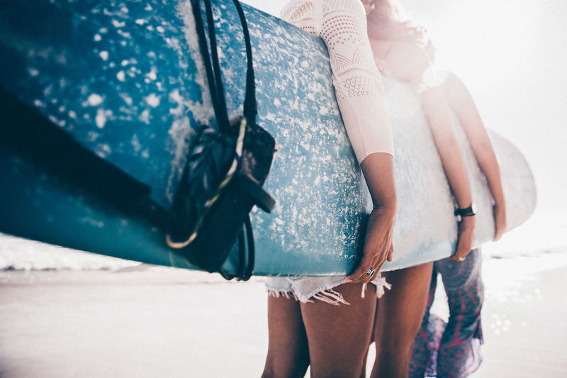 Real People Adult Women Togetherness Two People Day Leisure Activity Land Clothing Holding People Standing Human Leg Lifestyles Focus On Foreground Body Part Nature Beach Floral Pattern Surfboard Surfing Vacations Adventure