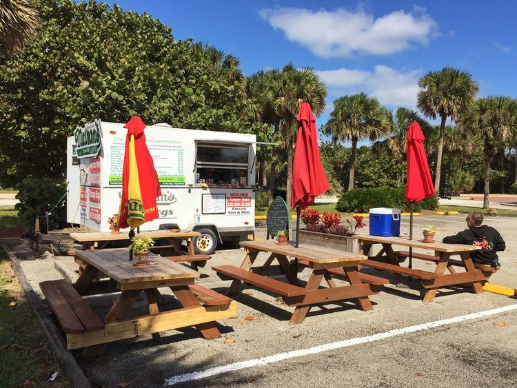 Hot dog stand at doggie beach. Melbourne Melbourne Beach Florida Beach Park Hot Dog Stand Umbrellas Picnic Tables
