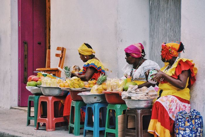 Cartagena, the city where colors have flavours. Real People Working Food Occupation Freshness Paint The Town Yellow Adapted To The City Lifestyle Fruit Stand Fruit Flavour Life In Colors Lifestyles Street Vendor Color The Street Photographer - 2017 EyeEm Awards Urban Lifestyle Streetphotography Women Around The World Cartagena Colombia Public Space Street Urban Spaces EyeEm Diversity This Is Latin America