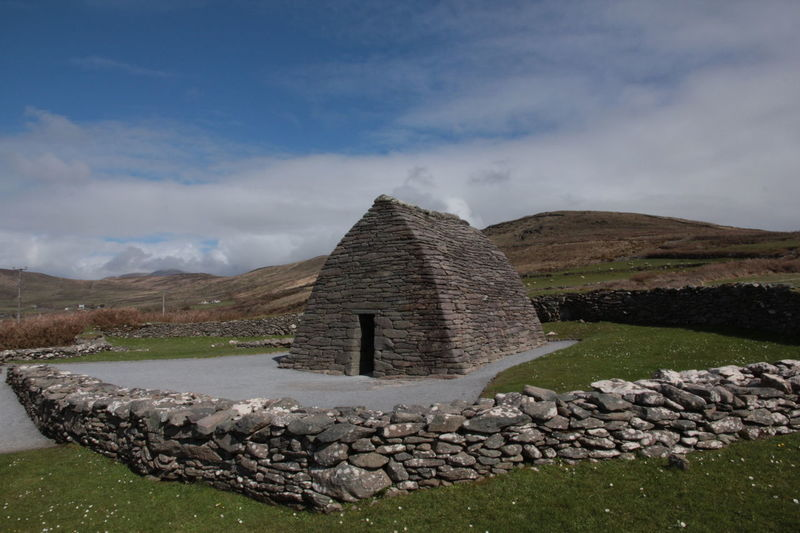 Gallarus Oratory 12th Century Ancient Architecture Ancient Irish Architecture Blue Sky Christian Church Gallarus Oratory Green Hills Green Hills And Sky Irish Archaeology Irish Architecture Stone Building Stone Wall First Eyeem Photo