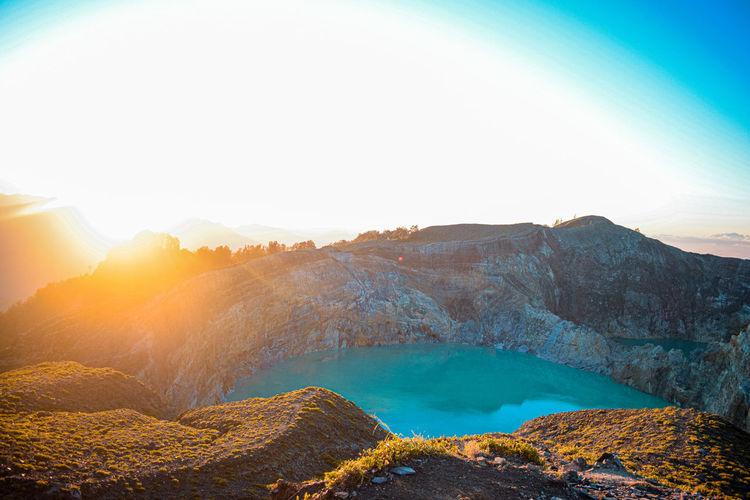 sunrise over the volcano crater INDONESIA East Nusa Tenggara Sunrise Sunrise Colors Warm Colors Warm Light Nature Mountain Tea Crop Water Lake Sky Landscape Cloud - Sky Mountain Peak Volcano Rocky Mountains Volcanic Crater Sulphur Mountain Range