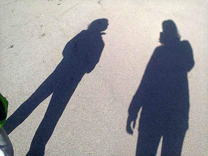 Shadow Focus On Shadow Sunlight Real People Lifestyles Togetherness High Angle View Men Long Shadow - Shadow Outdoors Day People Adult Only Men Adults Only