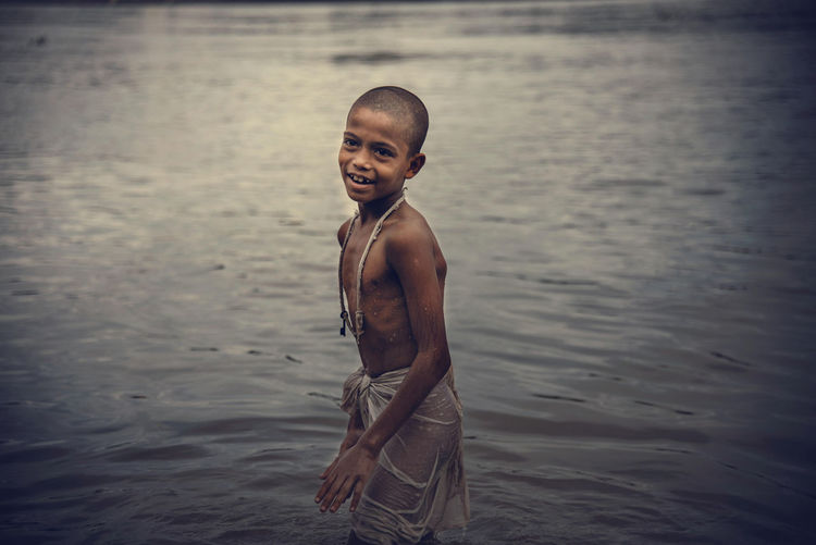 CalcuttaInstagrammers Ganga Ghat In India Indian Culture  Mahalaya Morning Light Tarpan Ankle Deep In Water Beauty In Nature Calcuttadiaries Childhood Eyeem Gallary Full Length Ganga River Portrait Sea Shirtless