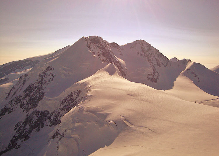 Scenic view of snowcapped mountains against sky, lyskamm summits in monte rosa chain, alps, italy.