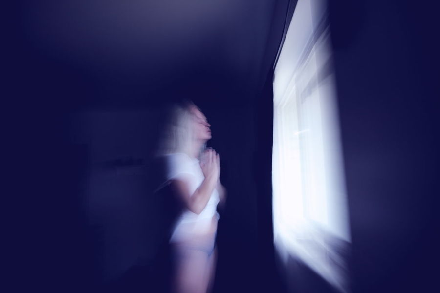 Blurred Motion One Person Indoors  Motion Defocused Emotion Sadness Night Portrait Dark Depression - Sadness Side View Prayer Transendence Adult Emotional Stress Contemplation Young Adult Despair Hopelessness