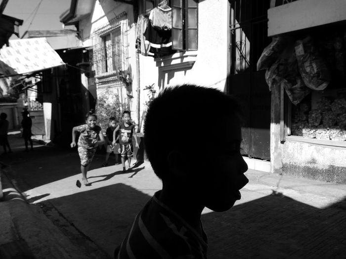 Childhood Child Leisure Activity Street Headshot Side View Streetphotography Blackandwhite Eyeem Philippines Mobilephotography