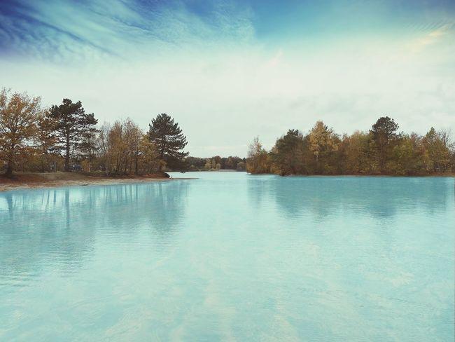 Blue lake. Sea Water Sun Beautiful Autumn Blue Lake Forrest Landscape Nature Trees Beautiful Nature