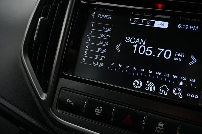 A car air conditioning switches and a multimedia display unit Screen Close-up Control Panel Display Gauge Illuminated Indoors  Interface Multimedia Navigational Equipment Technology Touch Screen