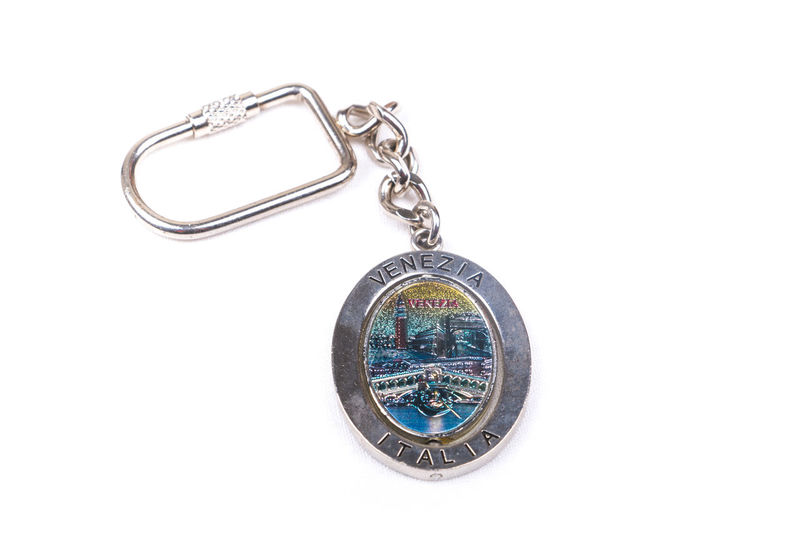 Key chain souvenir from Venice, Italy on a text list of country names background Capital City Collection Destination Gift Italy Journey Key Chain Single Object Souvenir Tourism Travel Trip Venice Venice, Italy White Background
