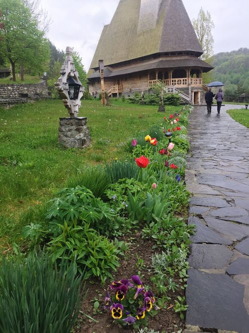 Flower Architecture Nature Outdoors Growth Beauty In Nature Building Exterior Day Built Structure Green Color Plant Grass Sky Wood Romanianbeauties Romania Romanian Lands Romanian Culture Romanian Architecture Romanian Nature Monastery Wooodenmonastery Let's Go. Together.