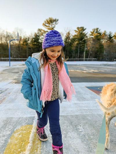 Full length of girl wearing hat in snow