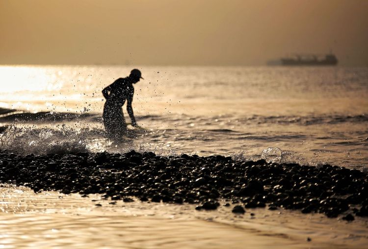 Fisherman Water Sea Beach Sky One Person Sport Real People Land Men Motion Nature Lifestyles Beauty In Nature Sunset Wave Horizon Over Water Splashing Leisure Activity Outdoors