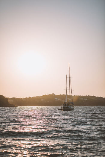 Lost In The Landscape Beauty In Nature Clear Sky Day Mast Mountain Nature Nautical Vessel No People Outdoors Sailboat Sailing Sailing Ship Scenics Sea Sky Sunlight Sunset Tall Ship Tranquil Scene Tranquility Transportation Travel Destinations Water Waterfront
