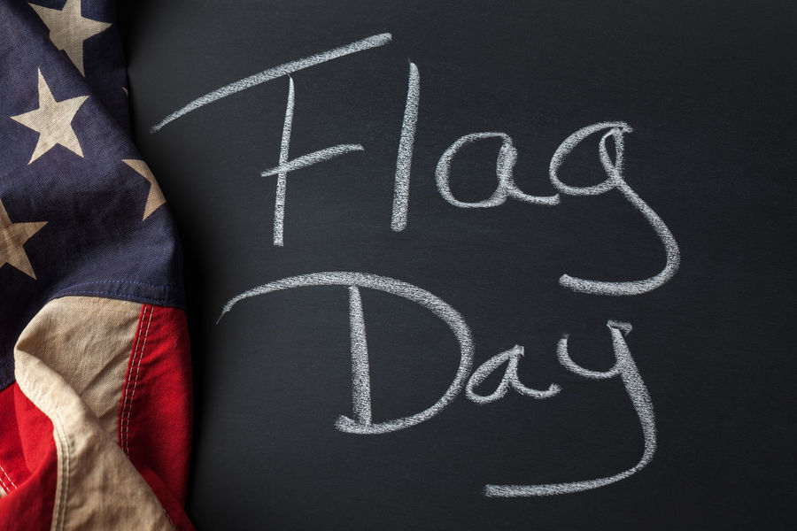Flag Day written on a chalkboard draped with a vintage American flag Flag American American Flag Americana Holiday Patriotic Patriotism Art And Craft Blackboard  Board Chalkboard Directly Above Flag Day Handwriting  High Angle View Message Messages No People Text Vintage