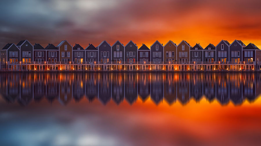 Sunset Holland Wooden House Reflection Water Sky Architecture Built Structure Nature Cloud - Sky Sea No People Building Exterior Dusk Travel Destinations Beach Night Building Outdoors Multi Colored Scenics - Nature