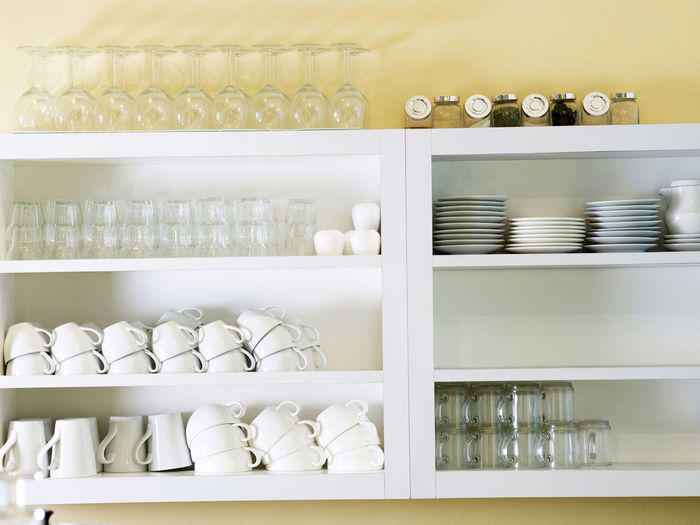 Crockery arranged on shelves at home