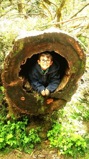 Sebastian in fallen tree. Pacific northwest washington state ice caves Child Day Smiling Happiness Nature Water Grass Cheerful Outdoors Portrait Boys EyeEmNewHere