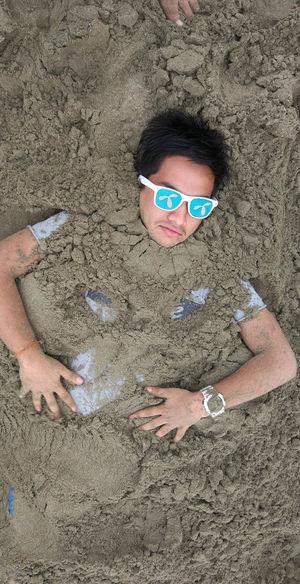 High angle view of man wearing sunglasses on beach