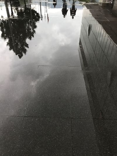 Building Exterior Real People Water Reflection Outdoors Day Puddle High Angle View Lifestyles Wet Low Section One Person Women Built Structure Road Architecture Men Nature Human Body Part Sky