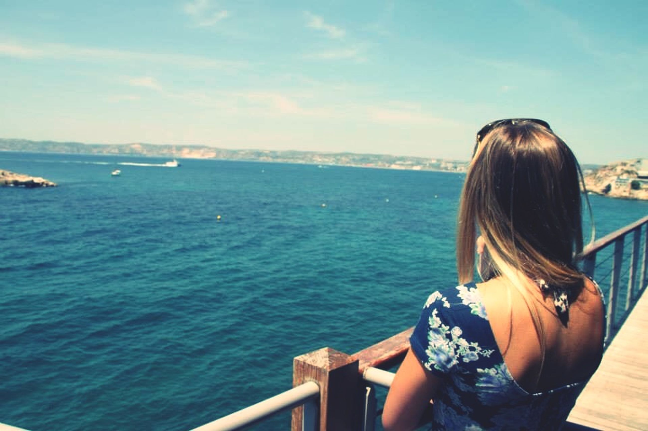 water, sea, lifestyles, leisure activity, young adult, rear view, sitting, young women, long hair, nautical vessel, sky, person, vacations, scenics, boat, relaxation, horizon over water, looking at view